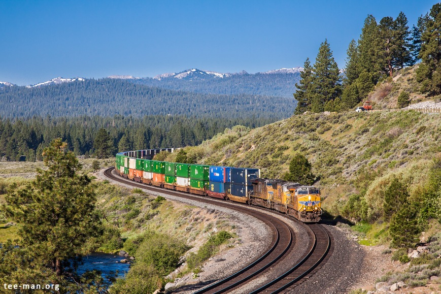 An eastbound doublestack container train rounds the bends east of Truckee. 6.6.2014