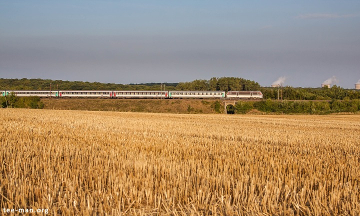 SNCF's 26160, one of only 2 engines of this series in multiservice livery, hauls the last Eurocity of the day to Switzerland. Seen here at Kanfen, in front of Cattenom nuclear power plant. 8.8.2015